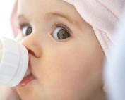cute baby drinking bottle weaning night feeds