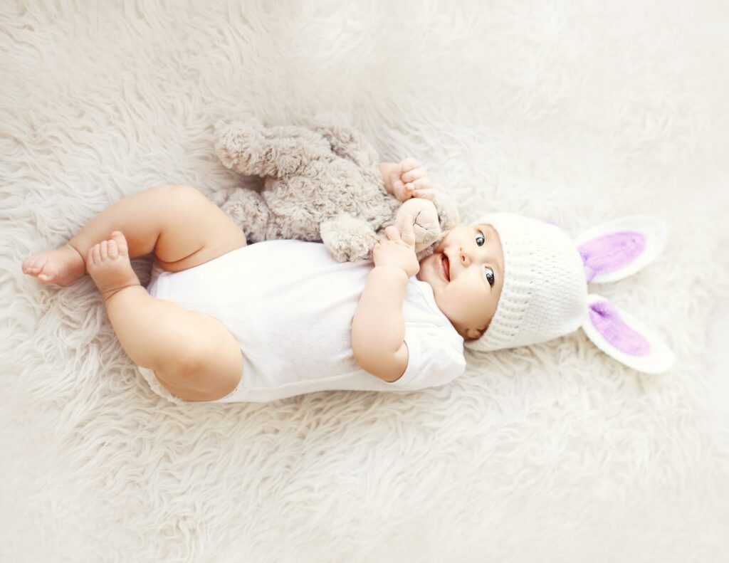 cute easter baby hugging lovey