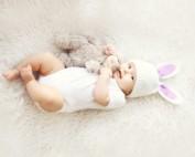 cute easter baby hugging lovey