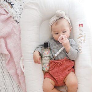 cute baby girl in dockatot
